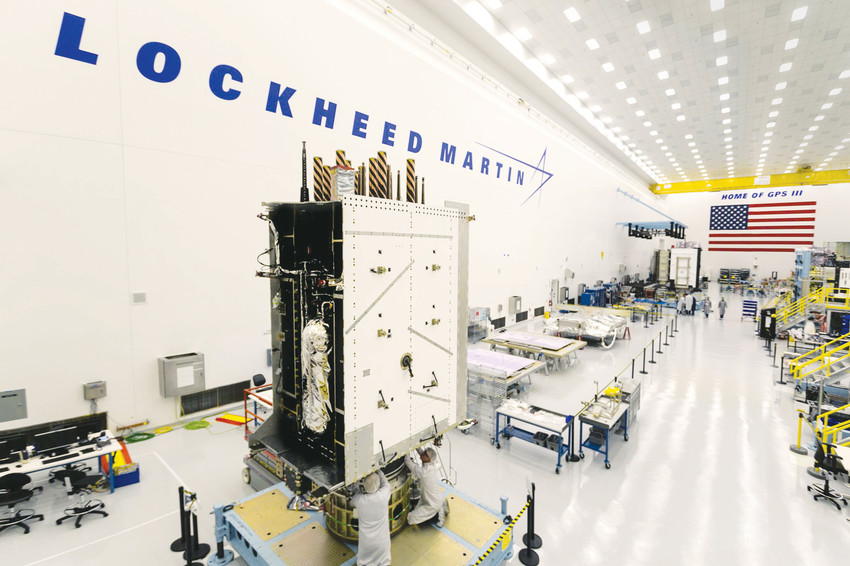 Technicians work on a global positioning system satellite at Lockheed Martin's Waterton Canyon campus last August. Lockheed is one of the heavy hitters of the Colorado aerospace industry.
