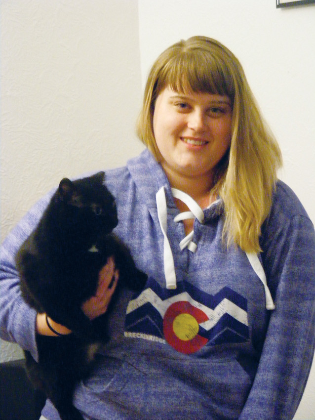 Shelby Harrigan and her cat, Mama. Harrigan moved to Denver from Ohio and works with children with autism.