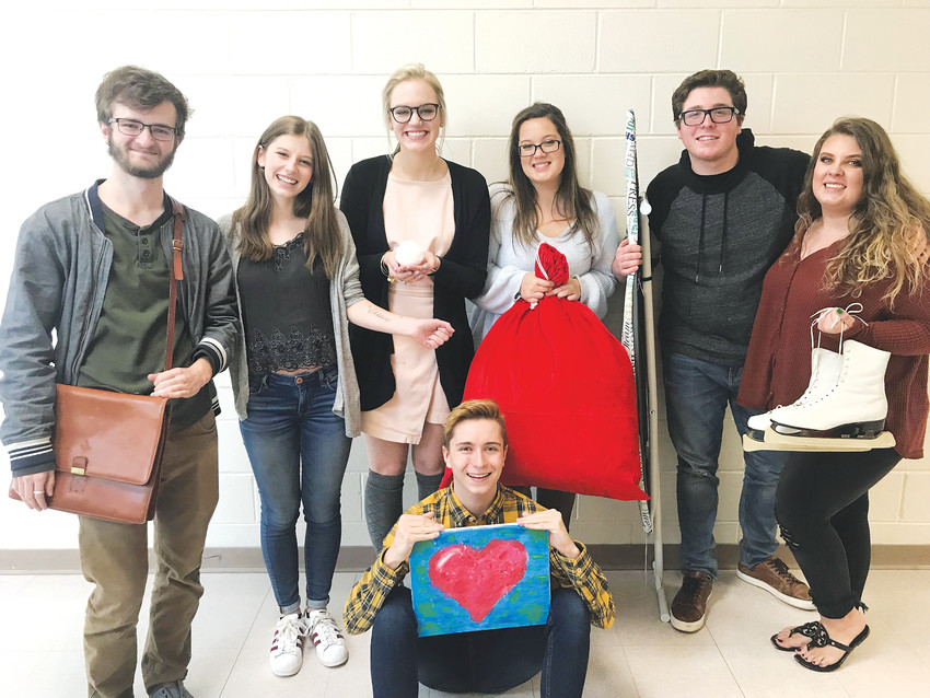 "Advanced theater students direct the various segments of ""Almost Maine"" at ThunderRidge High School. Here, they hold related objects."