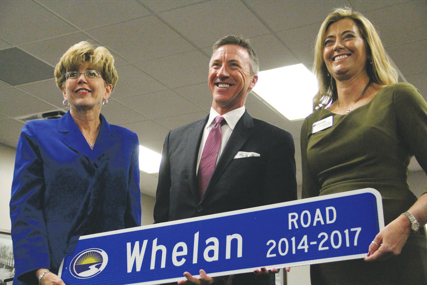 "From left, former Mayor Cathy Noon, former Councilmember Charles ""C.J."" Whelan and Mayor Stephanie Piko pose for photos at the Centennial City Council's Jan. 8 meeting, where outgoing councilmembers received commemorative street signs and farewell remarks from Noon. Whelan represented District 4, the northeastern corner of the city."