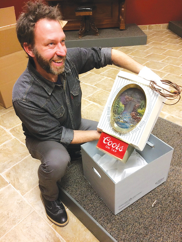 Mark Dodge, curator at the Golden History Museum, packs a Coors sign in preparation for the museum's moving day, which was Jan. 9. The museum's artifacts will be placed in an offsite storage for the remodel when new artifacts will be brought in.