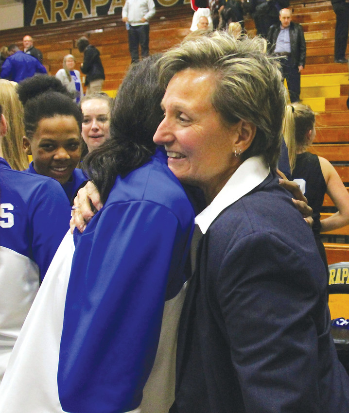 Caryn Jarocki receives a hug from a player after winning her 600th career game on Dec. 7 against Arapahoe.