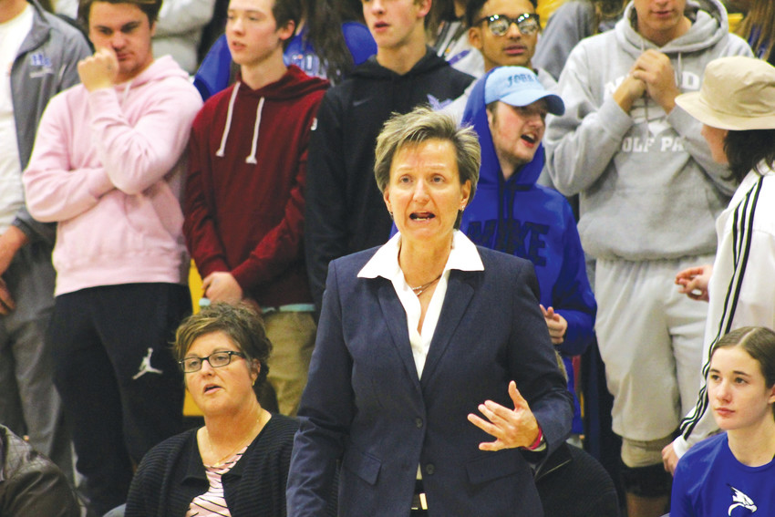 Caryn Jarocki's trademark intensity is on display during a Dec. 7 game against Arapahoe. Her team went on to win, giving Jarocki her 600th career win.
