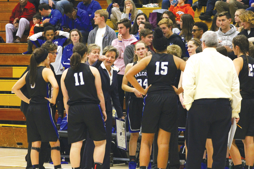 Caryn Jarocki huddles with her team during a timeout in the Dec. 7 game against Arapahoe.