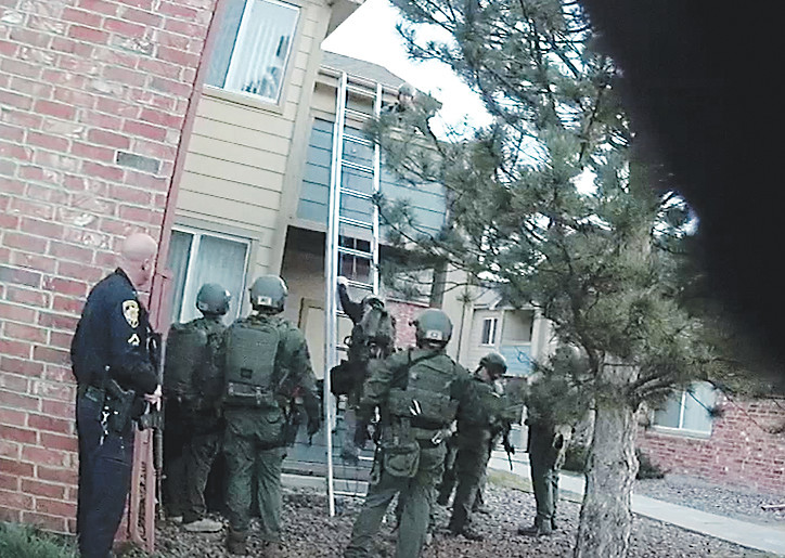 This still image taken from a body camera video released by the sheriff's office shows members of the regional SWAT team securing the perimeter near Matthew Riehl's apartment on Dec. 31.