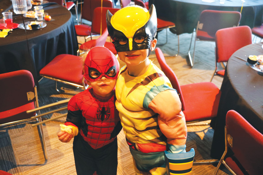 The Woods brothers stop for a snap at Superheroes Unite on Jan. 13 at Southridge Recreation Center, 4800 McArthur Ranch Rd. Hosted by HRCA, the annual event gives kids an opportunity to meet real-life superheros.
