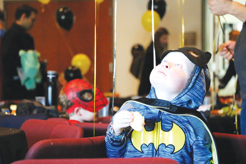 Oscar Thompson, 4, is memorized by colorful balloons at HRCA's annual Superheroes Unite event .