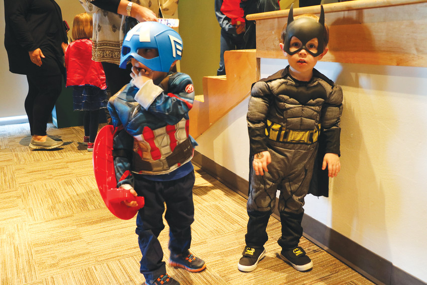Patrick Donahue, 3, left, and Ryder Goike, 3, sport their best superhero costumes at Superheroes Unite.