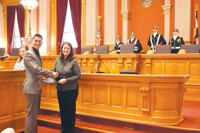 Ponder Stine, of Cherry Creek High School and the University of Colorado Boulder, shakes United States Rep. Diana DeGette's hand at a Jan. 12 ceremony to honor her nominees to U.S. service academies. The ceremony at the old Supreme Court chambers at the Colorado State Capitol hosted nominees and their family members.