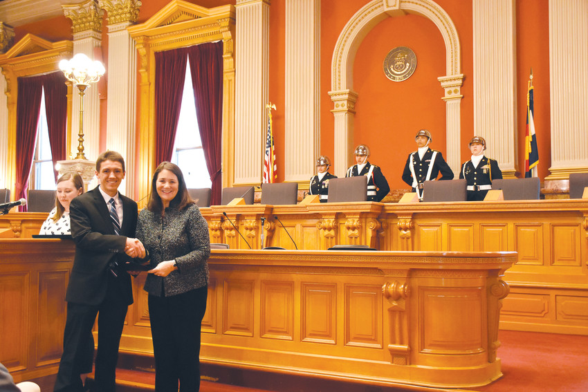 Mitchell Cook, of Cherry Creek High School, shakes United States Rep. Diana DeGette's hand at a ceremony to honor her nominees to U.S. service academies Jan. 12. The ceremony at the old Supreme Court chambers at the Colorado State Capitol hosted nominees and their family members.