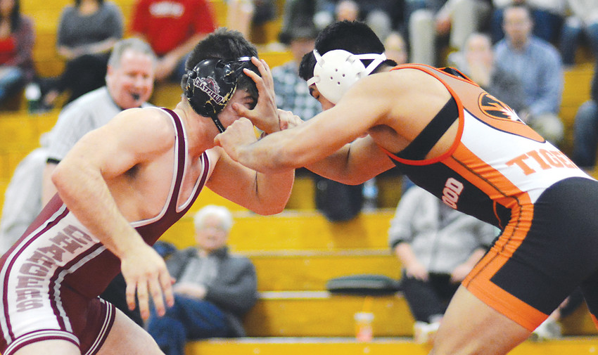 Lakewood senior Gabe Dinette, right, locks up with Chatfield senior E.C. Manzanares during the 160-pound match during a Class 5A Jeffco League dual Jan. 18 at Chatfield High School. Dinette, a two-time state champion, won 9-1.