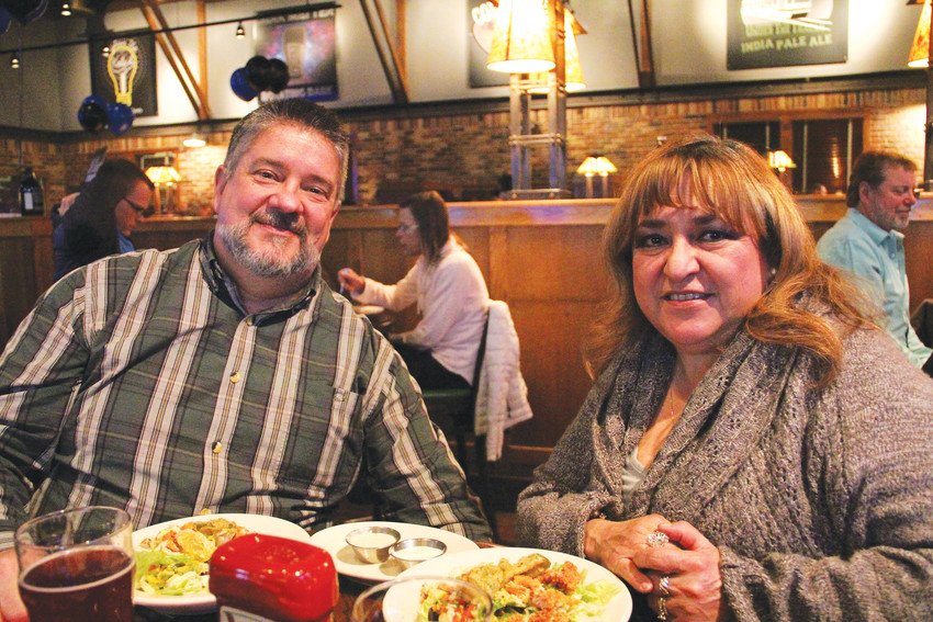 Wayne Gordon, 53, left, and Maria Gordon, 57, eating at Rock Bottom Restaurant and Brewery Jan. 17 on the night of the event to honor Deputy Zackari Parrish. The Gordons have been coming to Rock Bottom for decades.