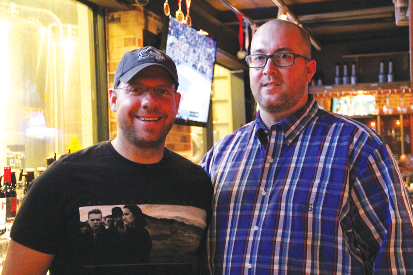 Douglas County Sheriff's Deputy Joseph Layman, left, stands with assistant general manager Steven Barry at Rock Bottom Restaurant and Brewery in Centennial Jan. 17. Barry led Rock Bottom in hosting an event to raise money for the family of Deputy Zackari Parrish, who was killed in a shooting in Highlands Ranch Dec. 31.