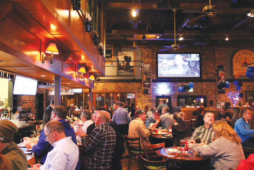 The crowd at Rock Bottom Restaurant and Brewery Jan. 17, amid an event to raise money for the family of Deputy Zackari Parrish. Proceeds from the sale of a certain craft sour beer, named ZPIII in honor of Parrish, were donated to the Fallen Officer Fund of Douglas County Foundation.