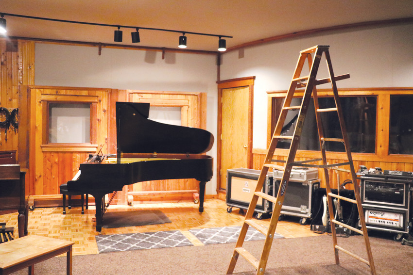 A grand piano and various guitar amplifiers sit in one of the recording studios in Denver's Rocky Mountain Recorders. The company has top of the line audio equipment to help musicians capture the best sound possible.