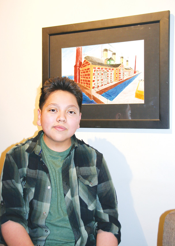 "John Luna, an eighth-grader at Carmody Middle School in Lakewood, has his picture taken with ""The Pumphouse,"" his colored pencil rendition of the Titanic's pumphouse on Jan. 18 at the Foothills Art Center's member preview event for Power of Process: A Jeffco School Exhibition and the art center's Members' Show."
