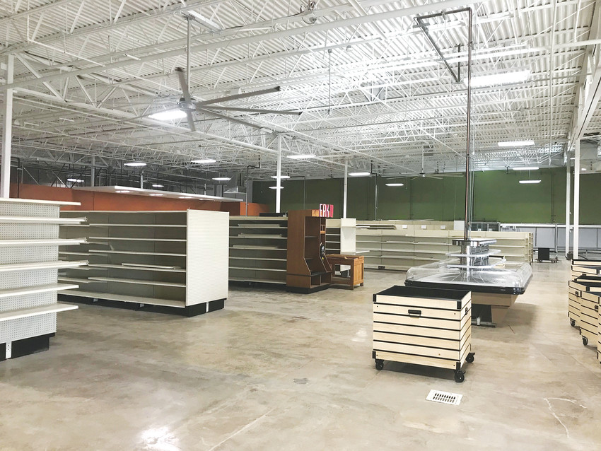 Crews move shelves into place at the Westminter Local Foods Campus, on track for a Feb. 10 opening.