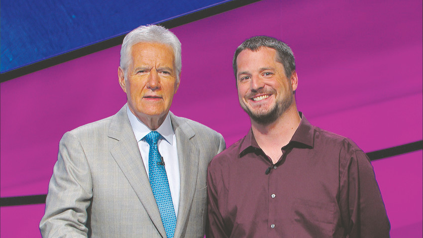"Alex Trebek, left, host of the game show ""Jeopardy!"", stands with contestant Jeff Machusko. Machusko, a Centennial resident, competed on the episode that aired Jan. 25."