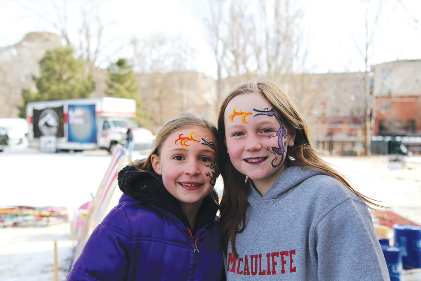Sisters Josie McGarry and Stella McGarry show off their dragon face paint. Dragons are one of their favorite animals.