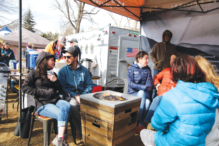 Festival attendees warm up by the fire at the UllrGrass Music and Beer Festival Jan. 28.