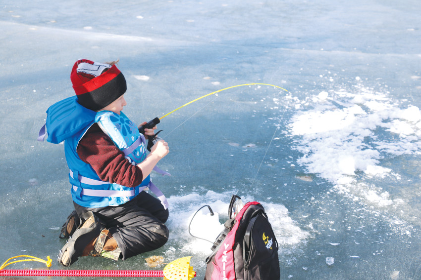 Bear Creek Lake Park ice fishing students test out the waters during their first ice fishing experience on Jan. 20.