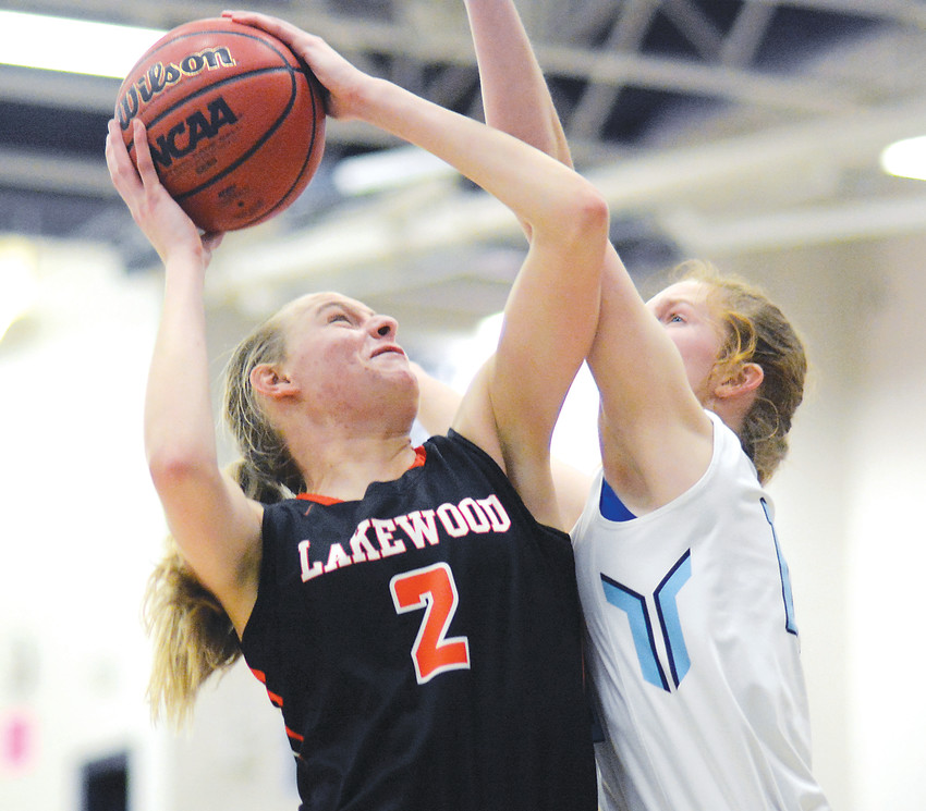Lakewood senior Camilla Emsbo (2) is fouled by Ralston Valley senior Samantha Van Sickle, right, during the second half Jan. 26 at Ralston Valley High School. Emsbo had 19 points in the Tigers' 50-44 victory.