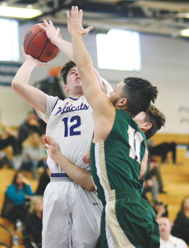 Arvada West senior James Pelon (12) scored a game-high 22 points in the Wildcats' dominating 66-41 victory over Bear Creek on Jan. 27 at Arvada West High School.
