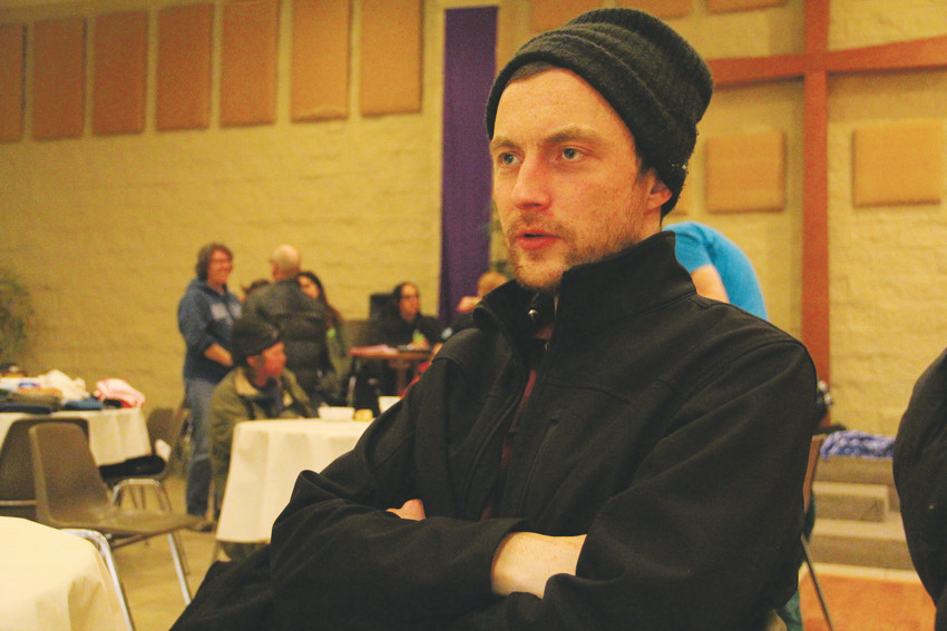 Rich Newton, 32, sits at one of the tables where homeless people ate dinner at Faith Community Center church during a survey carried out by area volunteers to count how many homeless people stay in the Denver metro area Jan. 29. Newton grew up in the Lakewood and unincorporated Jefferson County area, and now stays on the streets in Englewood.