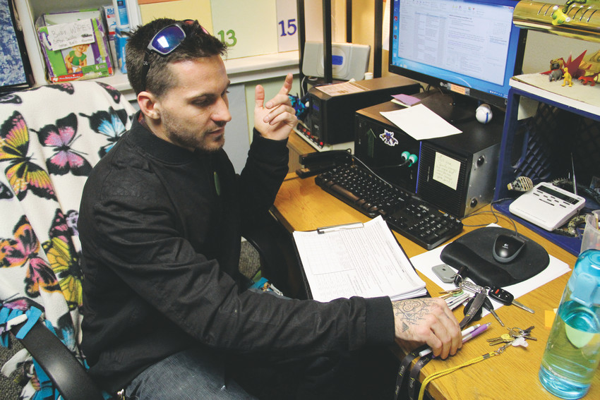 Patric Hughes, a case manager at House of Hope — a shelter for homeless women with children in Englewood — sits at his desk in between trips to different places in the south Denver metro area to administer the Point-in-Time survey counting homeless people Jan. 29. Hughes visited places in the Sheridan and Englewood areas along the South Platte River, as well as the Faith Community Center church.