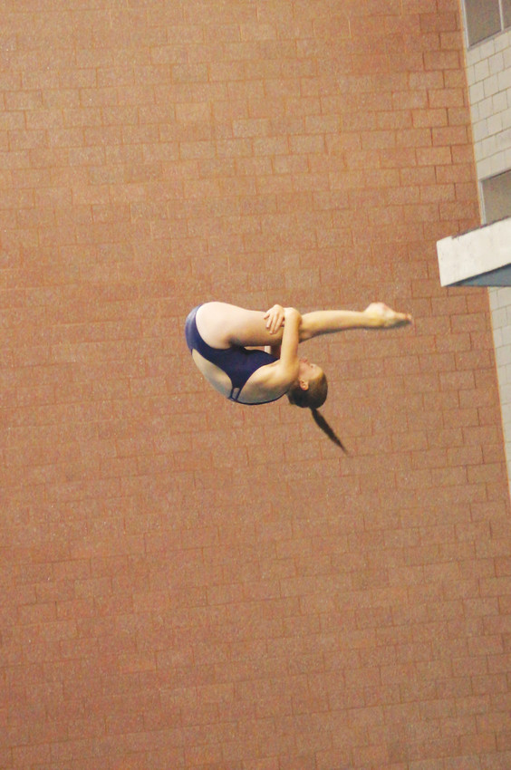 "Ralston Valley freshman Izzy Gregersen has been diving for five years and is on a team with many inexperienced divers that are not club divers. ""I don't coach them but I really try to encourage them,"" she said."
