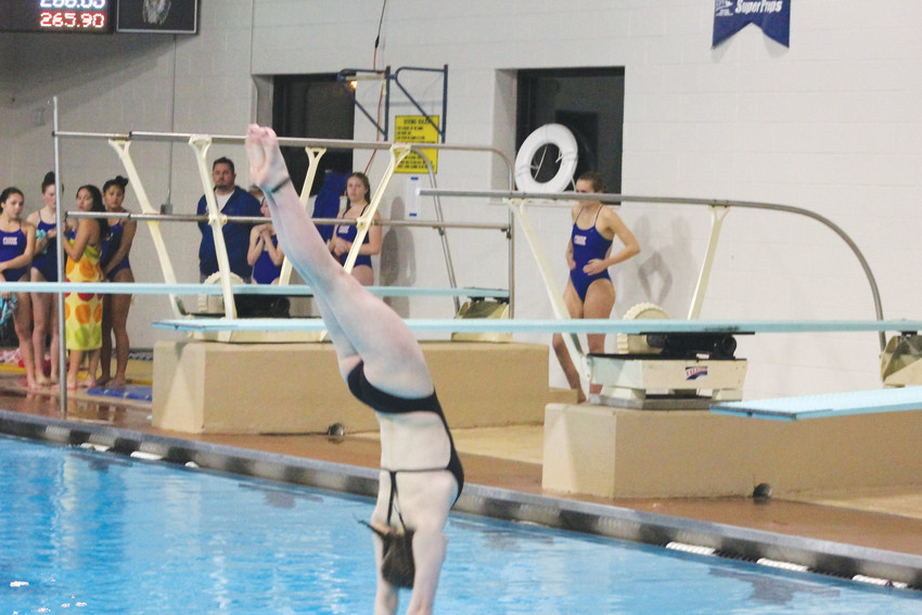 "Arapahoe junior Franny Cable took a beginning diving class as a freshman as she was looking for something to do to replace gymnastics. She has developed into one of the state's top divers and says, ""I want to win state but it's going to be really tough. It can just come down to the degree of difficulty in the final round."""