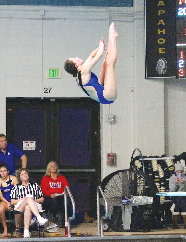 "Cherry Creek junior Addie Perlmutter is a former gymnast who switched has been diving for a year and a half. ""I can do what I used to love and turn it into something else,"" she said of her switch of sports."