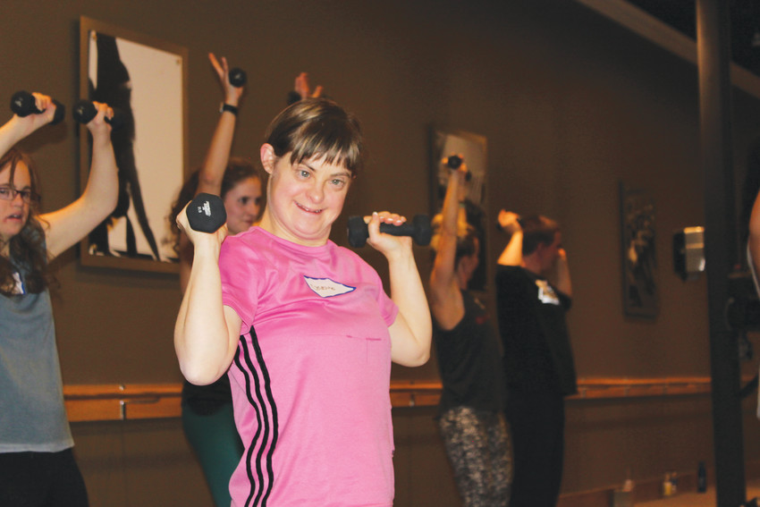 Casey Gunning, 34, feels the burn as she works out at Pure Barre Greenwood Village.