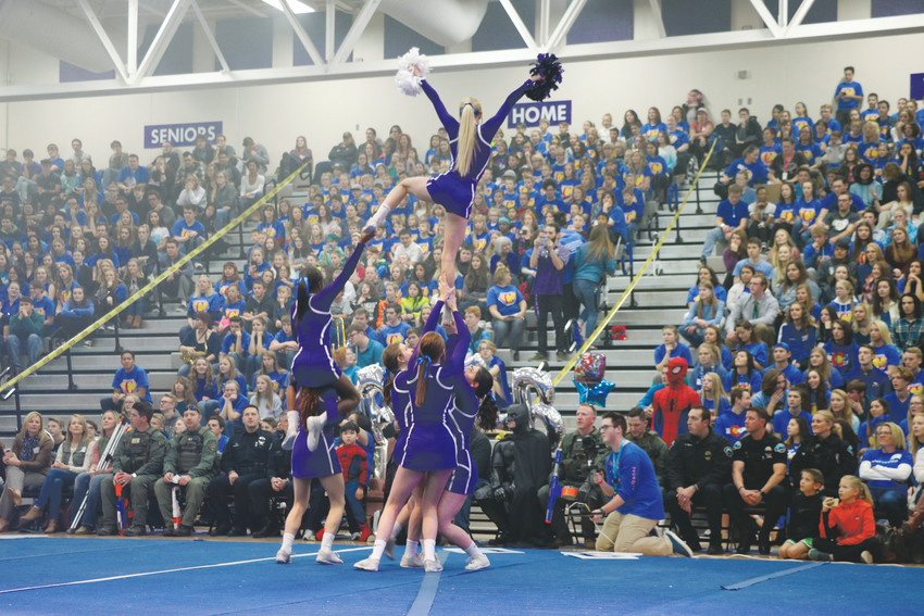 Douglas County High School cheerleaders perform at the school's annual Make-a-Wish assembly on Jan. 29. This year, the superhero-themed celebration honored Caleb Amaral, a 5-year-old battling T-cell leukemia.