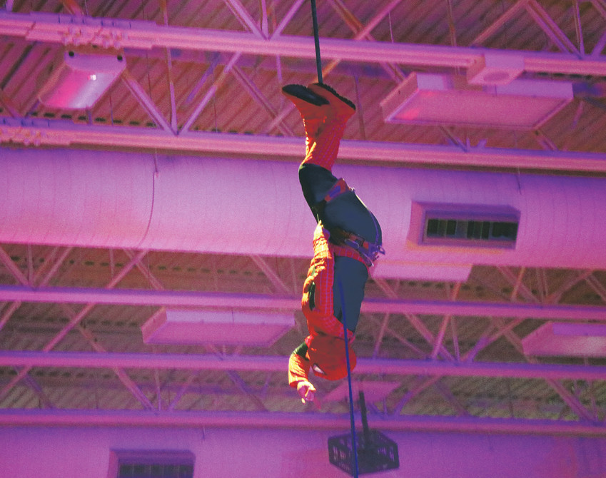 Spiderman repels from the ceiling at an assembly at Douglas County High School on Jan. 29. The school and its feeder schools were celebrating Make-a-Wish week, when they raised $47,000 for children battling life-threatening illnesses.