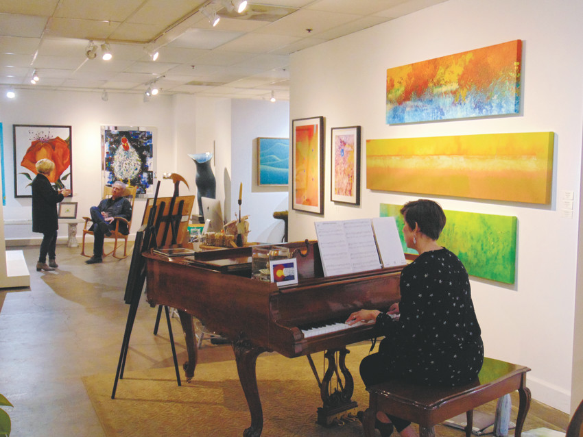 Pianist Julie Hall tinkles the ivory at Outnumbered Gallery's final First Friday show. The gallery will close at the end of February.