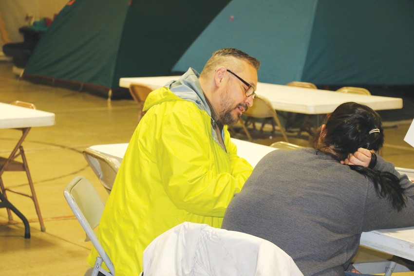 Tony Cisneros, a volunteer for the Point In Time Survey, interviews a homeless person staying the night at Mean Street Ministry's shelter on Jan. 29.