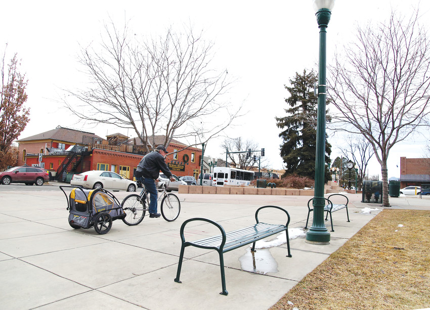 A homeless man bicycles through Olde Town Arvada Jan. 30. Volunteers at the nearby Rising Church and the Arvada Library conducted Point in Time surveys of the area's homeless population for the annual survey.