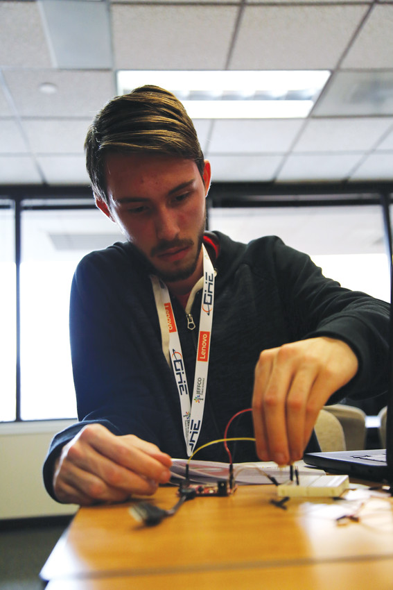 Columbine High student Kyle Dietrich builds a hack at the Jeffcon held Jan. 31.