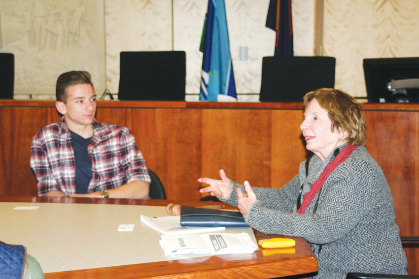 Enzo Perri, a sophomore student councilor at Golden High School, listens as Golden Mayor Marjorie Sloan leads conversation at a Lunch with the Mayor event on Jan. 31 at city hall.