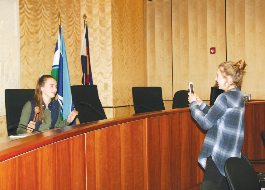 Stella Schneider, left, and Ella Ganter, two sophomores part of Golden High School's student council, play around in the mayor's chair following a Lunch with the Mayor event on Jan. 31 at city hall.