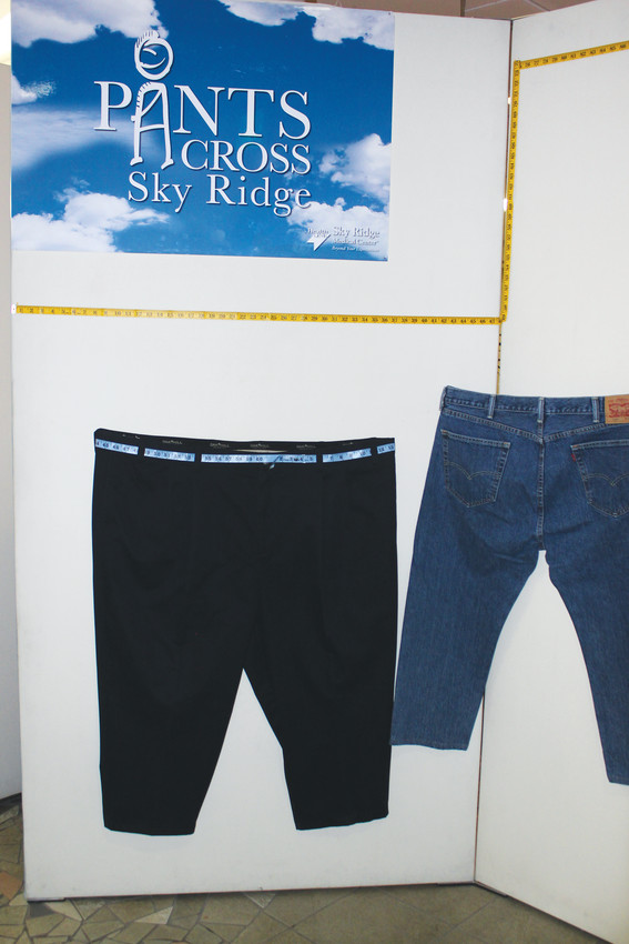 """Before"" and ""After"" pants line the walkway at Skyridge Medical Center, during a reception for patients who are in the weight loss program."