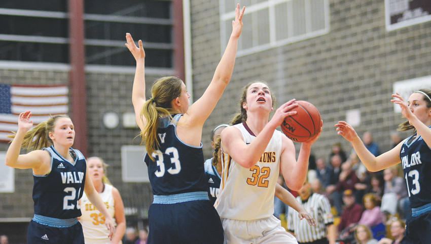 Golden senior Makena Prey (32) went for 20 points and 10 rebounds against Valor Christian on Feb. 2 at Golden High School. It wasn't enough as the Demons lost their third Class 4A Jeffco League game of the season.