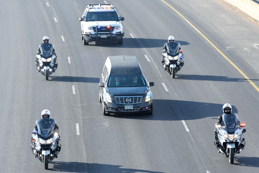A hearse carrying the body of slain Adams County Sheriff's Deputy Heath Gumm, heads north on I-25 at 160th Avenue, before joining the formal funeral procession at Colorado Highway 7,  Friday, February 2, 2018.