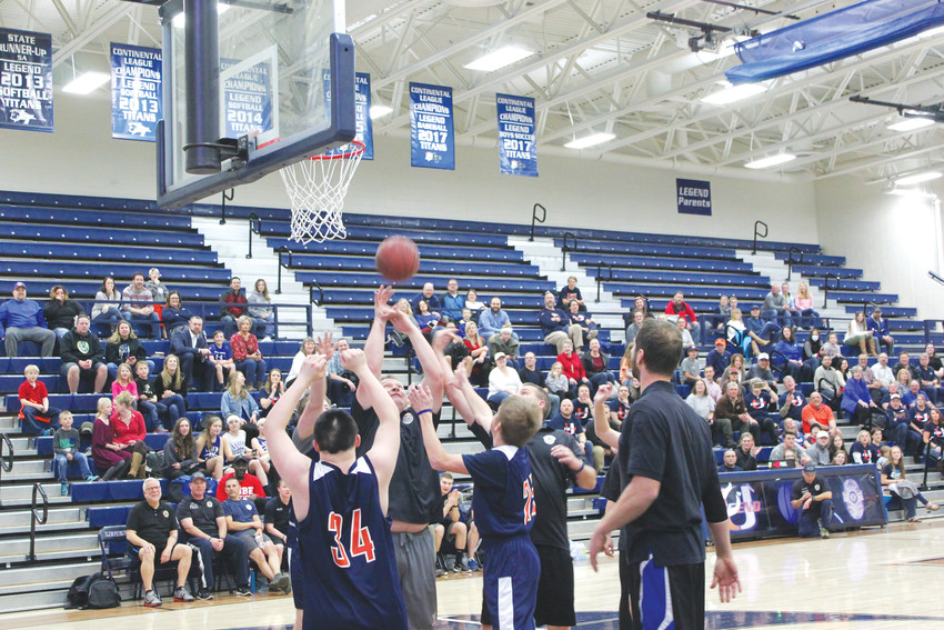 Officers from Parker Police Department scramble for the rebound against Legend Unified basketball team.