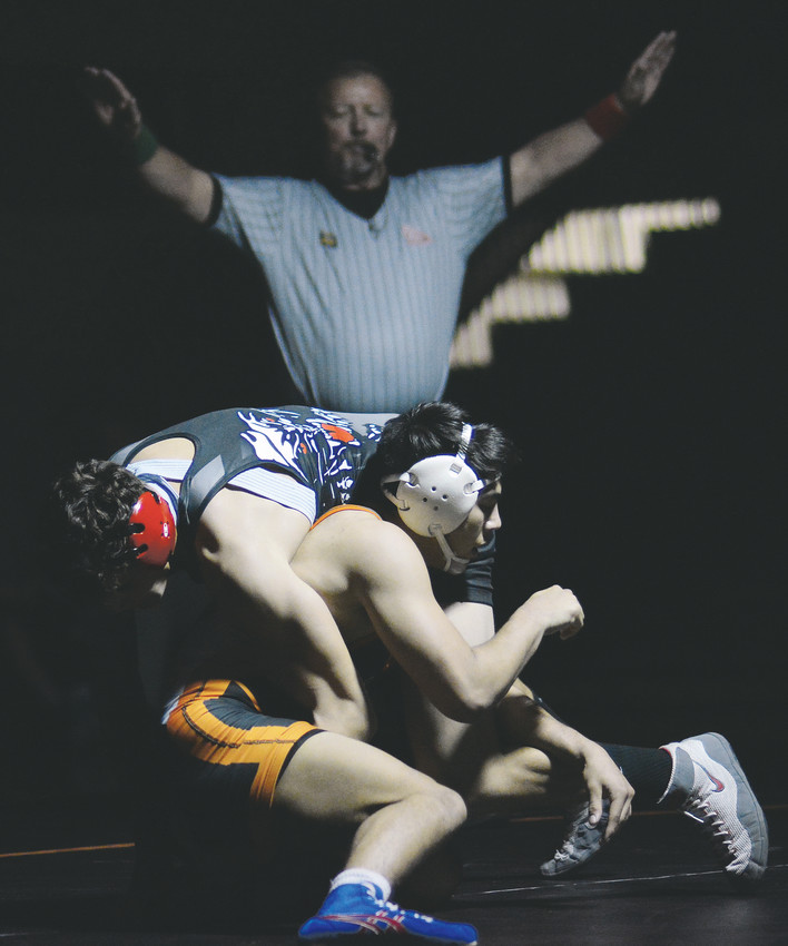 Lakewood's Gabe Dinette, right, is favored to win a third individual state wrestling title at Pepsi Center in Denver.