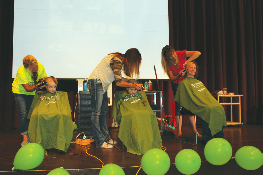 "Volunteer cosmetologists shave the heads of volunteers during last year's St. Baldrick ""Brave the Shave"" event at Elizabeth High School."