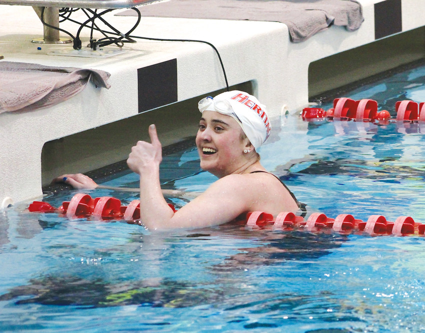 Heritage senior Kylie Andrews acknowledges Eagles fans and teammates after winning the 100-yard freestyle and defending her state championship at the Class 4A state swimming championships, which concluded Feb. 10 at the Veterans Memorial Aquatics Pool in Thornton.