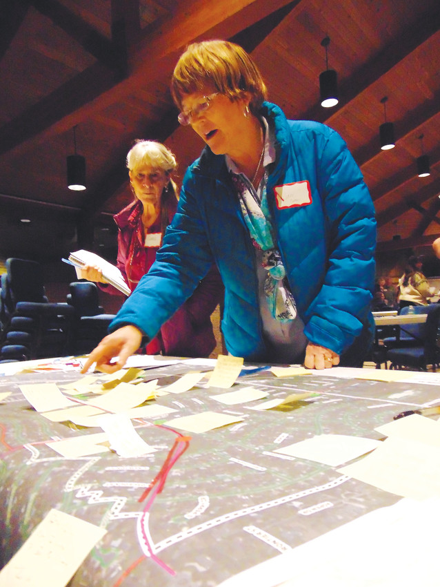 Carol Brzeczek, left, and Jane Carlson look over a map of the Belleview Corridor crowded with notes left by community members spelling out their concerns or hopes for the area. The city is in the midst of developing a planning document to guide redevelopment along the corridor in coming years.