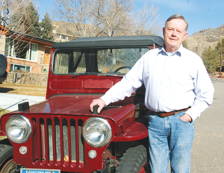 Bill Robie, 73, stands with his 1949 Willys Jeep. Robie has lived in Golden since 1964, and has named 28 streets in and around Golden.